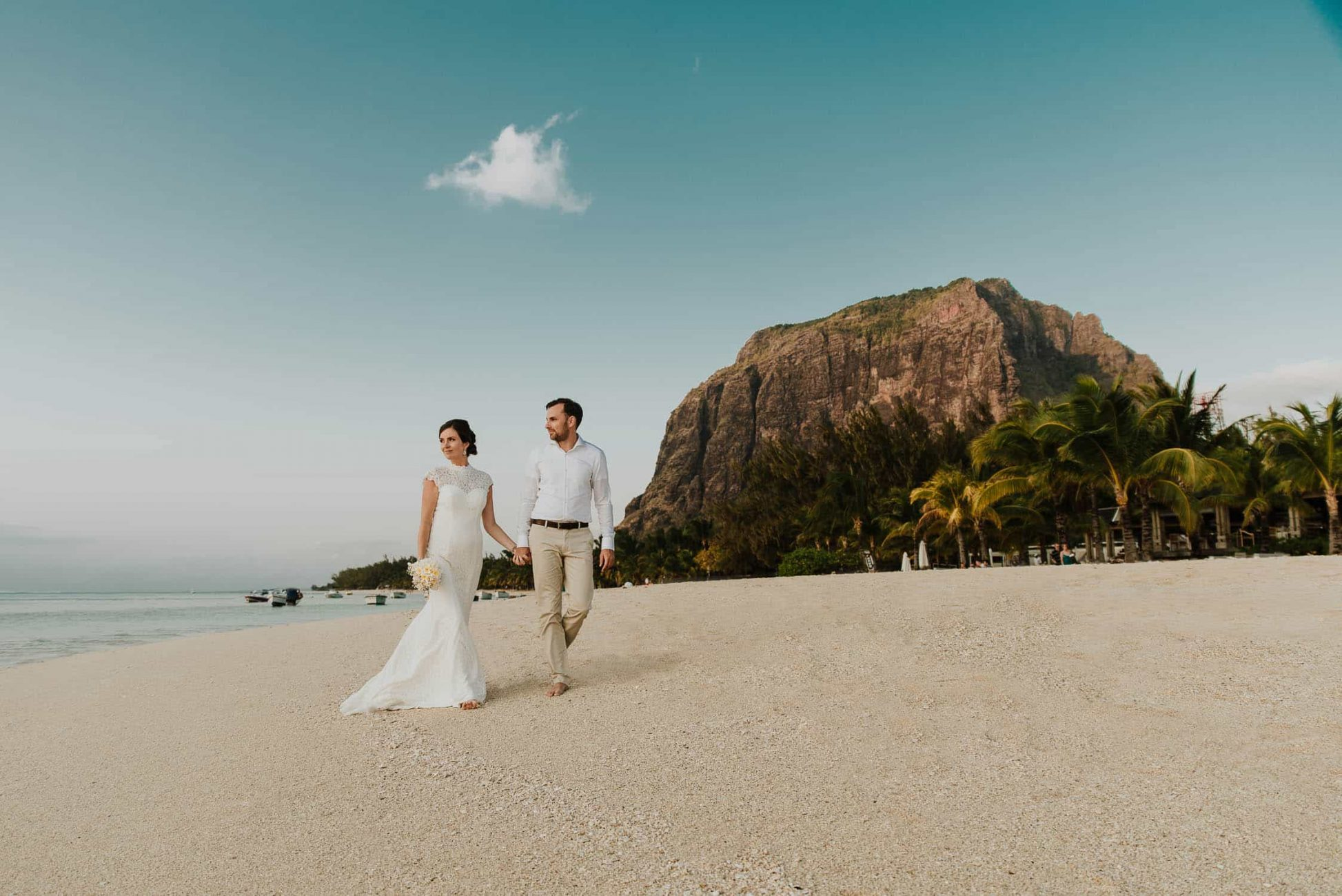 Wedding Couple walking by Le Morne beach in Mauritius