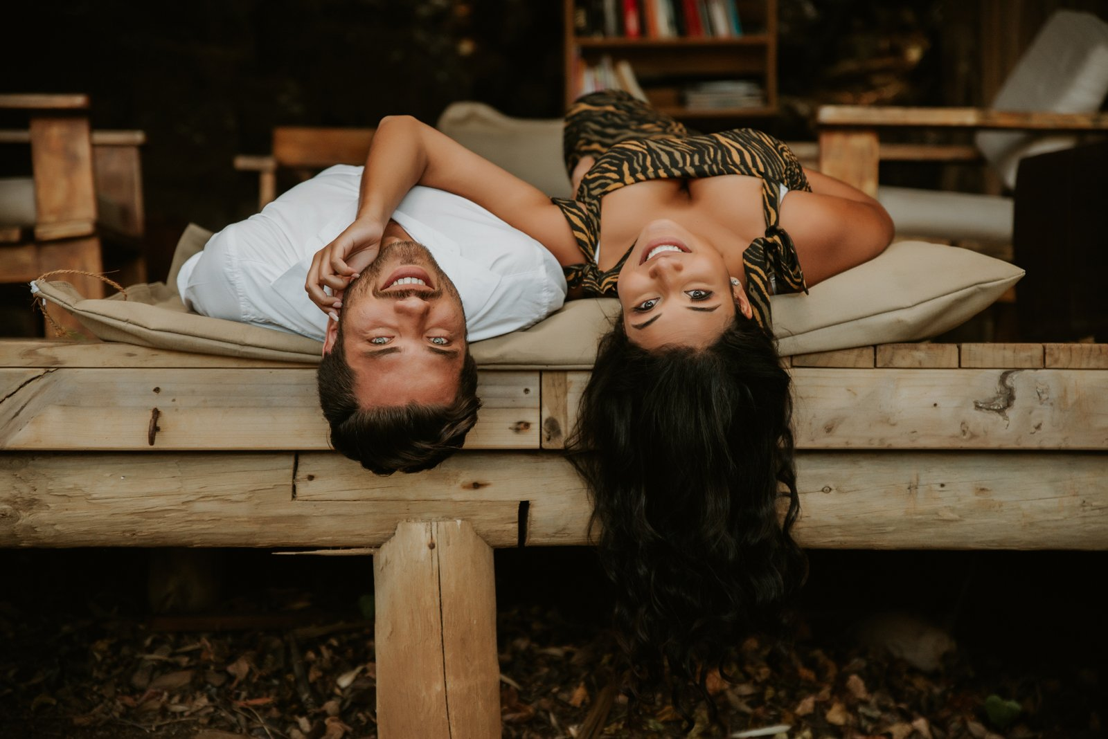Couple laying on wooden palette